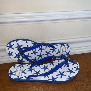 kate spade flip flops and kate spade wristlet.